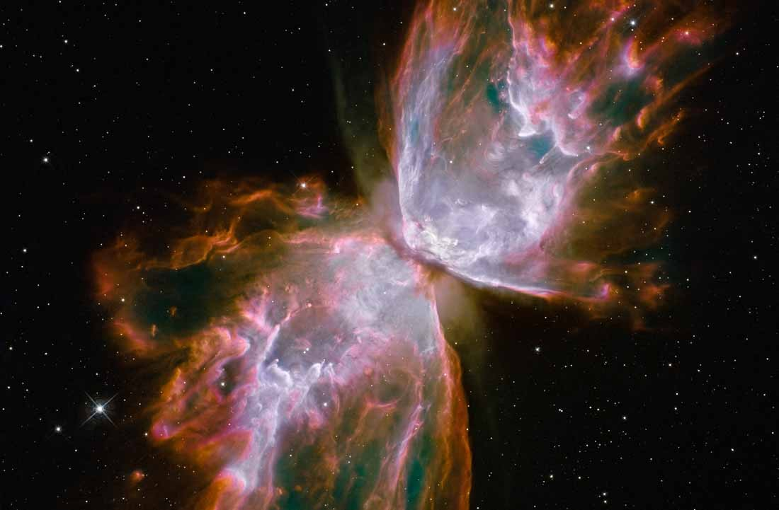 "This celestial object looks like a delicate butterfly. But it is far from serene. What resemble dainty butterfly wings are actually roiling cauldrons of gas heated to nearly 20 000 degrees Celsius. The gas is tearing across space at more than 950 000 kilometres per hour — fast enough to travel from Earth to the Moon in 24 minutes! A dying star that was once about five times the mass of the Sun is at the centre of this fury. It has ejected its envelope of gases and is now unleashing a stream of ultraviolet radiation that is making the cast-off material glow. This object is an example of a planetary nebula, so-named because many of them have a round appearance resembling that of a planet when viewed through a small telescope. The Wide Field Camera 3 (WFC3), a new camera aboard the NASA/ESA Hubble Space Telescope, snapped this image of the planetary nebula, catalogued as NGC 6302, but more popularly called the Bug Nebula or the Butterfly Nebula. WFC3 was installed by NASA astronauts in May 2009, during the Servicing Mission to upgrade and repair the 19-year-old Hubble. NGC 6302 lies within our Milky Way galaxy, roughly 3800 light-years away in the constellation of Scorpius. The glowing gas is the star's outer layers, expelled over about 2200 years. The ""butterfly"" stretches for more than two light-years, which is about half the distance from the Sun to the nearest star, Proxima Centauri. The central star itself cannot be seen, because it is hidden within a doughnut-shaped ring of dust, which appears as a dark band pinching the nebula in the centre. The thick dust belt constricts the star's outflow, creating the classic ""bipolar"" or hourglass shape displayed by some planetary nebulae. The star's surface temperature is estimated to be over 220 000 degrees Celsius, making it one of the hottest known stars in our galaxy. Spectroscopic observations made with ground-based telescopes show that the gas is roughly 20 000 degrees Celsius, which is unusually hot compared to a typical planetary nebula. The WFC3 image reveals a complex history of ejections from the star. The star first evolved into a huge red giant, with a diameter of about 1000 times that of our Sun. It then lost its extended outer layers. Some of this gas was cast off from its equator at a relatively slow speed, perhaps as low as 32 000 kilometres per hour, creating the doughnut-shaped ring. Other gas was ejected perpendicular to the ring at higher speeds, producing the elongated ""wings"" of the butterfly-shaped structure. Later, as the central star heated up, a much faster stellar wind, a stream of charged particles travelling at more than 3.2 million kilometres per hour, ploughed through the existing wing-shaped structure, further modifying its shape. The image also shows numerous finger-like projections pointing back to the star, which may mark denser blobs in the outflow that have resisted the pressure from the stellar wind. The nebula's reddish outer edges are largely due to light emitted by nitrogen, which marks the coolest gas visible in the picture. WFC3 is equipped with a wide variety of filters that isolate light emitted by various chemical elements, allowing astronomers to infer properties of the nebular gas, such as its temperature, density and composition. The white-coloured regions are areas where light is emitted by sulphur. These are regions where fast-moving gas overtakes and collides with slow-moving gas that left the star at an earlier time, producing shock waves in the gas (the bright white edges on the sides facing the central star). The white blob with the crisp edge at upper right is an example of one of those shock waves. NGC 6302 was imaged on 27 July 2009 with Hubble's Wide Field Camera 3 in ultraviolet and visible light. Filters that isolate emissions from oxygen, helium, hydrogen, nitrogen and sulphur from the planetary nebula were used to create this composite image. These Hubble observations of the planetary nebula NGC 6302 are part of the Hubble Servicing Mission 4 Early Release Observations."